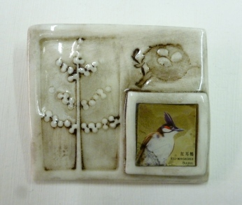 Brooch featuring porcelain